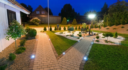 home garden: Panoramic view for modern villa garden at night Stock Photo