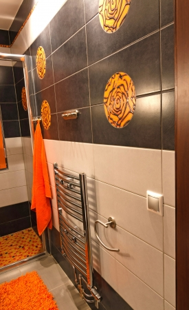 Wall with new toilet ceramics in orange   brown colors photo