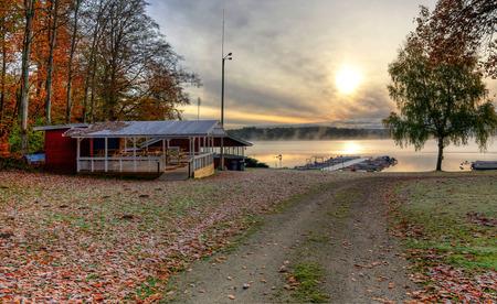 Autumn road to lake boat harbor photo