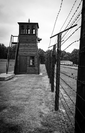 Vintage styled photo of camp fence and guard tower photo