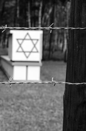 Old styled photo of Jewish symbols in Stutthof photo