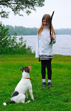 Young child girl trains the dog photo