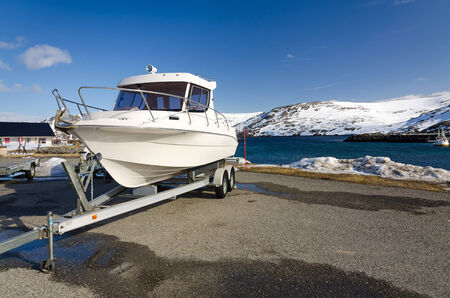 Fast fishing boat on a trailer Stock Photo