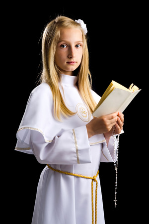 First communion for cute blonde girl photo