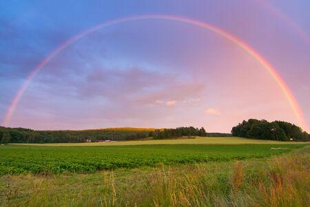 Rainbow over Swedish farm field photo