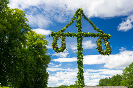 Swedish midsummer pole at blue sky Stock Photo - 29870880