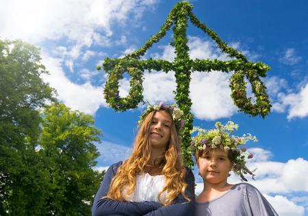 Adorable girls on midsummer Swedish party photo