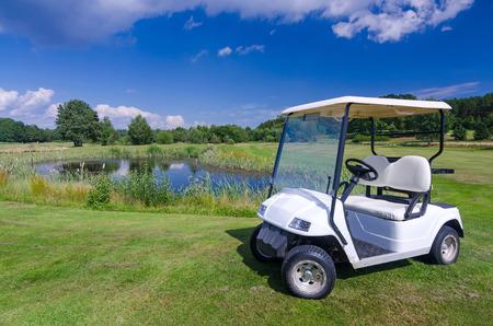 Golf car near the water pond