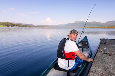 Canoe angler in Norwegian fjord