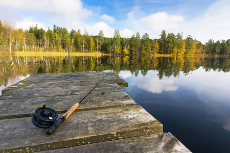 Autumn fly fishing in the lake photo