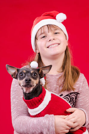 Child girl and dog in Christmas colors photo
