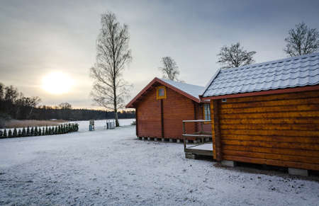 Swedish wooden cabins in winter time photo