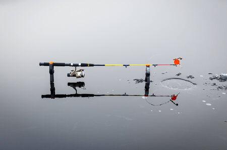 fish on ice: Pike ice fishing on the lake