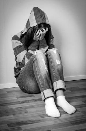 hooded sweatshirt: Depressed girl in hooded sweatshirt