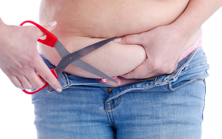 Women try to cut out fat stomach Stock Photo