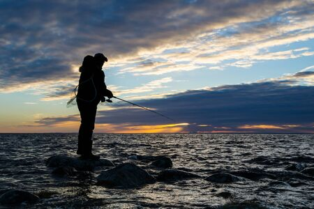 Sea fishing at evening photo