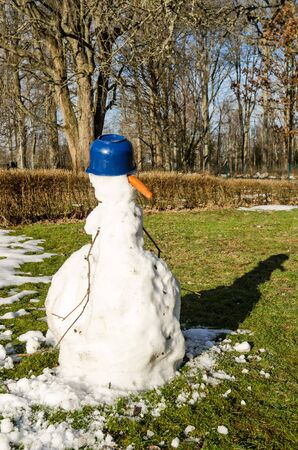 Melting snowman in home garden