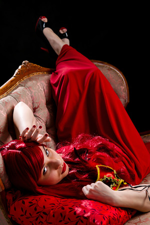 Beauty red-haired lady with party mask photo