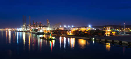 Gdynia city shipyard in panorama night view photo