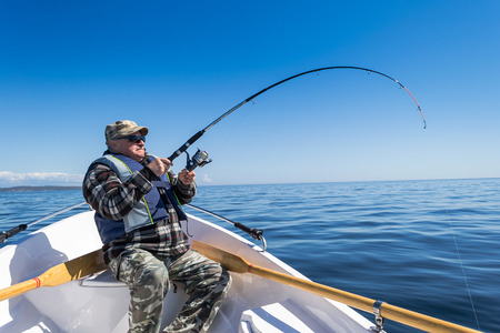 Senior sea fishing action
