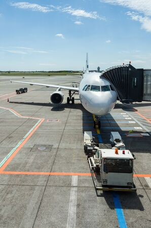 awaiting: Plane awaiting on passengers Editorial