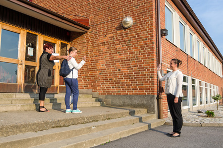 first day of school: Waving goodbye in first school day
