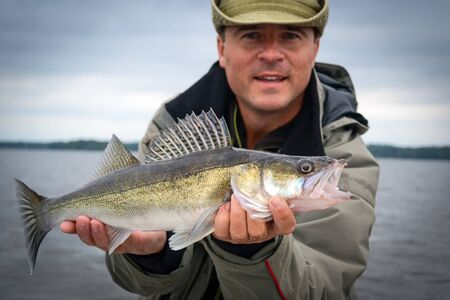 hand line fishing: Autumn walleye fishing in Sweden Stock Photo