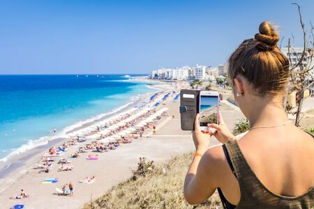 beach landscape: Girl taking a landscape photo of beautiful tropical beach