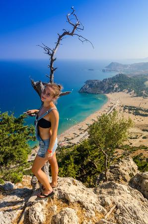 tsampika: Teenage girl tourist on Tsambika mountain Stock Photo