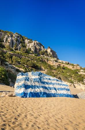 tsambika: Greece flag painted on Tsambika beach rock