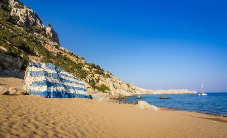 tsambika: Tsambika beach landscape with Greece flag