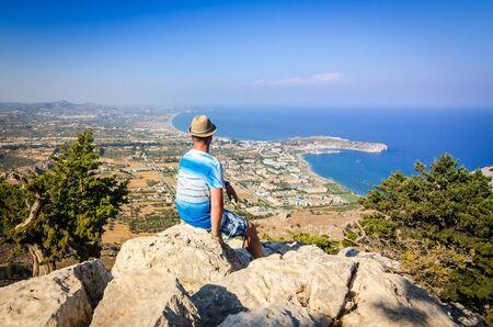 tsampika: Man enjoy a beautiful hill view