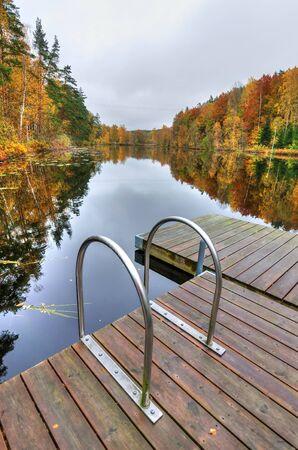 Bridge stairs to autumn lake
