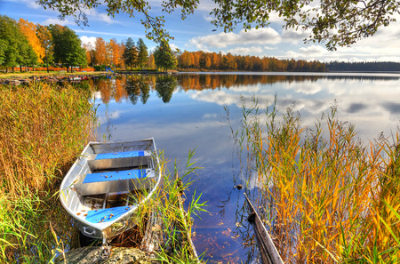 beautiful scenery: Alluminium boat in Swedish autumn scenery Stock Photo