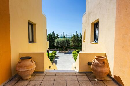 greek pot: Traditional Rhodes architecture with symbolical pots