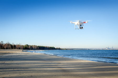 Drone flyes over Polish beach in winter season