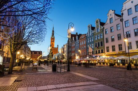 baroque architecture: GDANSK, POLAND - DECEMBER 29, 2016: Christmas tree and decorations in old town of Gdansk, Poland. Baroque architecture of the Long Lane is one of the most notable tourist attractions of the city.