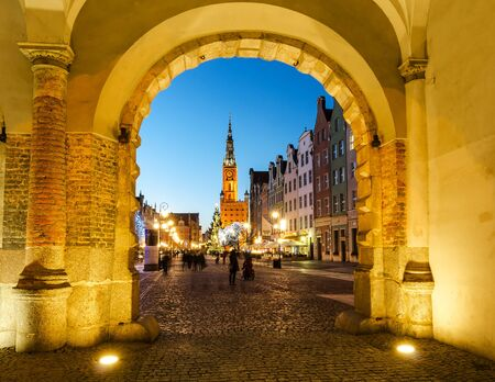 one lane: GDANSK, POLAND - DECEMBER 29, 2015: The Green Gate in the old town of Gdansk, Poland. Baroque architecture of the Long Lane is one of the most notable tourist attractions of the city.