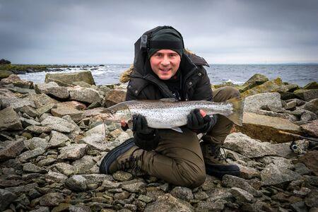 angler: Angler with big sea trout
