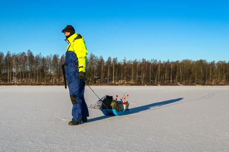 ice fishing: Man go ice fishing Stock Photo