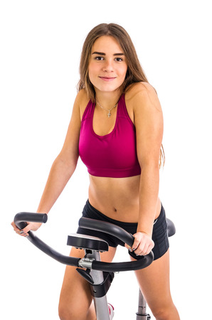 stationary bicycle: Girl trains on stationary bicycle