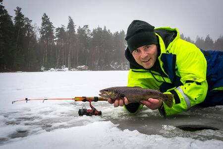 brown trout: Happy angler with brown trout fishing trophy