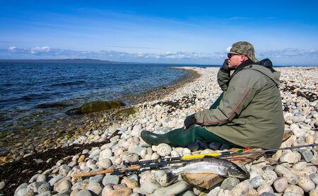 angler: Angler relaxing after sea fishing Stock Photo