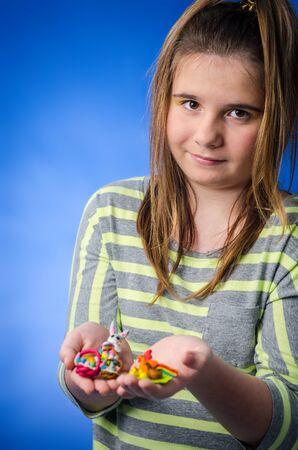 plasticine: Adorable girl shows plasticine Easters figures Stock Photo