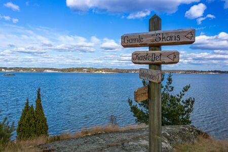swedish: Wooden signs on Swedish coast
