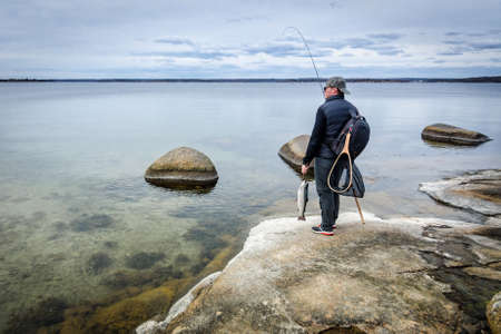 sea fishing: Angler on spring sea coast