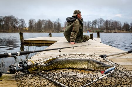 pike: Pike fishing in spring scenery