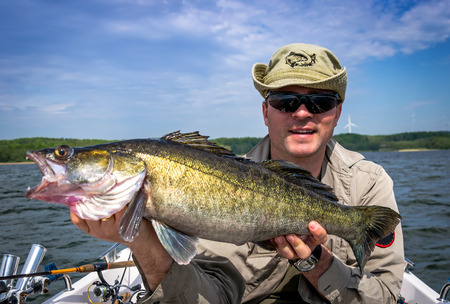 walleye: Angler with huge walleye fishing trophy