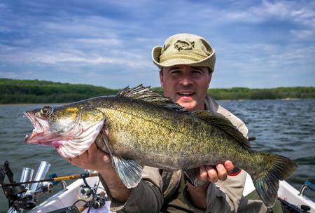 huge: Happy angler with huge walleye