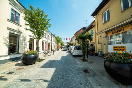 KARLSHAMN, SWEDEN - MAY 23, 2016: Spring street view in May 23, 2016 in Karlshamn, Sweden. Karlshamn is the port city in the Blekinge province, build in XVIl century, population 20000 residents.